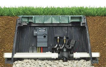 Короб с клапанами и трубопроводом в системе полива